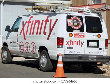 WESTMINSTER, COLORADO/U.S.A. - MARCH 20, 2013: Xfinity Comcast service van parked on the street in front of a customers home. The van has the company logo's on the sides and back.