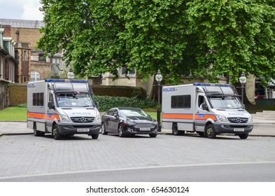 Westminster, London - 5th June 2017 - Two police vans and an undercover car stand outside the Houses of Parliament