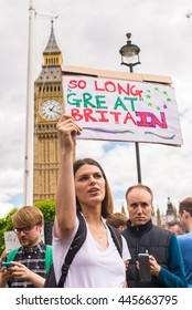 "Westminster, London, UK - 25 June 2016: Young female pro-remain protester carrying poster saying ""So long Great BritaIN"" as part of protests against Brexit in front of House of Parliament in London."