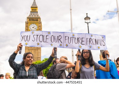 "Westminster, London, UK - 25 June 2016: Students carrying poster saying ""You stole our future from us"" as part of protests against Brexit in front of the House of Parliament in London, UK."