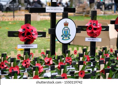 Westminster, London, UK. 4th November 2019. British Legion Volunteers blanket the gardens of Westminster Abbey with Crosses and Red poppies as they set up the Field of Remembrance at Westminster Abbey