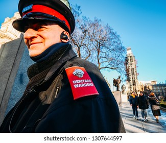 Westminster, London, UK - Feb 7, 2019: Heritage Warden keeps vigil in Parliament Square Gardens following a number of monuments in the city having recently been vandalised with white paint