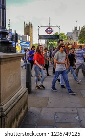 Westminster, London, uk - June 8, 2018: Group of people on the street outside the underground station at Westminster.