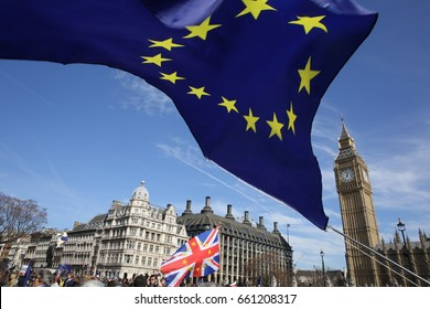 Westminster, London, Uk. March 25, 2017. The EU flag flutters in the wind at a Remain rally in Westminster. Talks on Brexit start next week after a horrendous fire in London and a hung parliament.