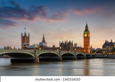 The Westminster Palace and the Big Ben clocktower at the river Thames in London, UK, just after sunset