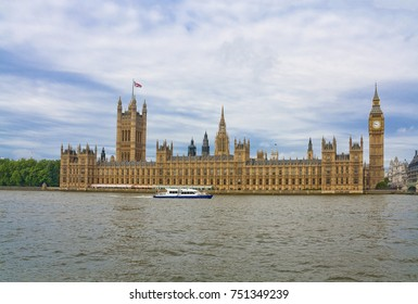 Westminster Palace with Big Ben seen across Thames river in London United Kingdom