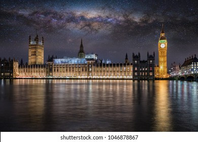 The Westminster Palace and Big Ben tower in London under the milkyway at night, United Kingdom