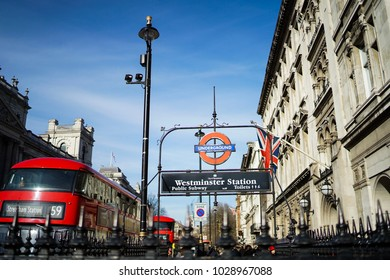 Westminster tube station with red bus background, London, United Kingdom on February 19, 2018