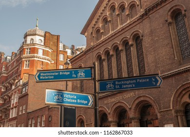 """Westminster,London/England - 26 May 2018 : A signpost in Westminster.Westminster Chapel can be seen in the background."