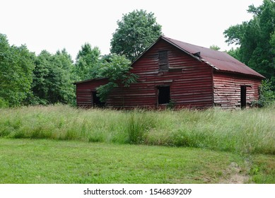 Westmoreland County, VA/USA - June 2, 2019: A weathered red barn near George Washington National Birthplace Monument.
