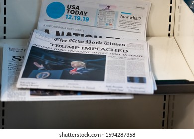 Weston, Florida/USA - December 20, 2019: Morning newspapers on the stand at local Gas station. A couple of Newspapers with top news about President Donald J. Trump Impeachment.