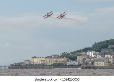 Weston-Super-Mare, Avon/UK - June 18 2016: The Breitling Stearman display team fly over the water.