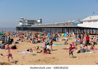 WESTON-SUPER-MARE, SOMERSET-MAY 7th 2018: Beautiful sunshine and warm weather drew visitors to the seaside for the bank holiday weekend at Weston-super-Mare, Somerset on Monday 7th May 2018
