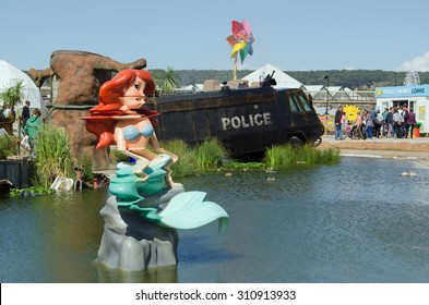 WESTON-SUPER-MARE, UK - AUGUST 26, 2015:  The Little Mermaid mutated by the toxic lake at Dismaland in Weston-Super-Mare.  The Banksy inspired parody fairground has attracted thousands of visitors.