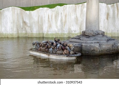 WESTON-SUPER-MARE, UK - AUGUST 26, 2015:  A traditional funfair attraction of remote controlled boats recreated by Banksy to reflect the issue of migrants trying to get into the UK.