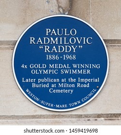 WESTON-SUPER-MARE, UK - JULY 23, 2019: A blue plaque on the wall of the Imperial Hotel commemorating Olympic swimming champion Paulo Radmilovic (1886-1968), who was once landlord there,