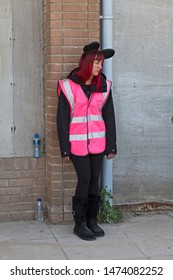 WESTON-SUPER-MARE, UK - SEPTEMBER 10, 2015: An attendant at Banksy's Dismaland exhibition.