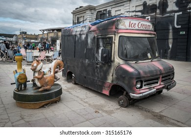 WESTON-SUPER-MARE, UK - SEPTEMBER 3 2015: Burnt out ice cream van at Banksy's Dismaland Bemusement Park. A five week show in the seaside town of Weston-Super-Mare.