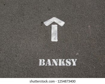 WESTON-SUPER-MARE, UK - SEPTEMBER 6, 2015: A sign painted on a pavement directing visitors to Banksy's art exhibition Dismaland.