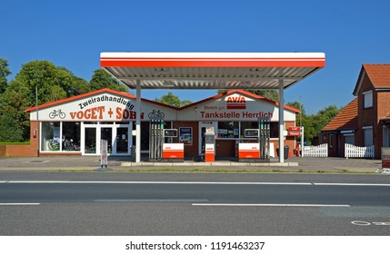westoverledingen, niedersachsen/germany - september 05, 2013: an avia gas station and a bicycle shop at federal road number 70 in between papenburg and leer