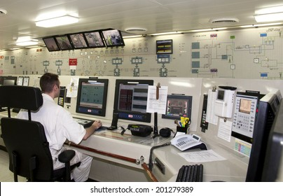 Westpoort, Netherlands - August 15, 2012 : Officer on duty in the Engine Control Room of a luxury cruise ship