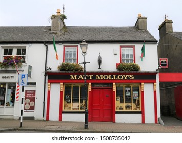 Westport, County Mayo, Ireland.  September 1, 2019.  The bright red door and front to Matt Molloy's Irish Pub.
