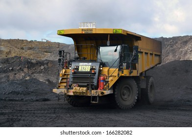 WESTPORT, NEW ZEALAND, JULY 12, 2013: A 70 ton truck waits for coal at Stockton open cast coal mine on July 12, 2013 near Westport, New Zealand. Stockton is the country's largest open cast coal mine.