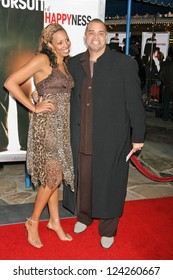 "WESTWOOD, CA - DECEMBER 07: Sinbad and wife Meredith at the premiere of ""The Pursuit of Happyness"" in Mann Village Theater December 07, 2006 in Westwood, CA."