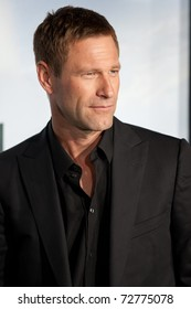 WESTWOOD, CA. - MARCH 8: Aaron Eckhart arrives at Columbia Pictures premiere of Battle: Los Angeles on March 8th 2011 at the Regency Village Theater in Westwood, Ca.
