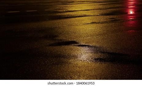 Wet asphalt, night view, neon reflection on the concrete floor. Night empty stage. Dark abstract background, dark street. Night city after rain, wet surface. Blurred background, night bokeh.