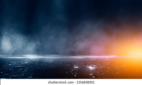Wet asphalt, reflection of neon lights, a searchlight, smoke. Abstract light in a dark empty street with smoke, smog. Dark background scene of empty street, night view,