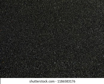 wet asphalt road texture, dark background