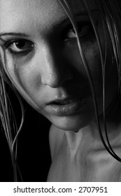 Wet beauty girl  over black background. Black&white. Close-up