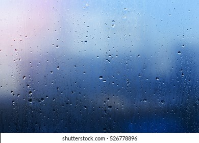 the wet blue window glass