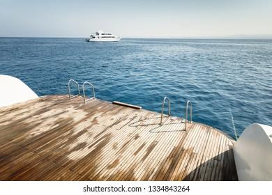 Wet boat deck against blue ocean