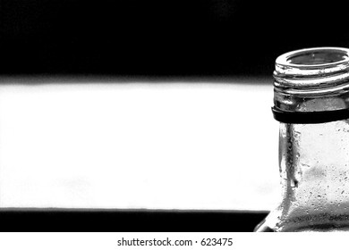 Wet bottle and black and white background