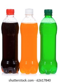 wet bottles with soda on white background