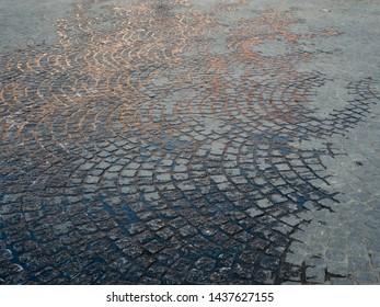 Wet cobblestones in a pattern,  Belgium