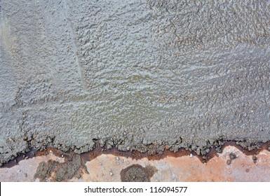 Wet concrete floor background. Top view.