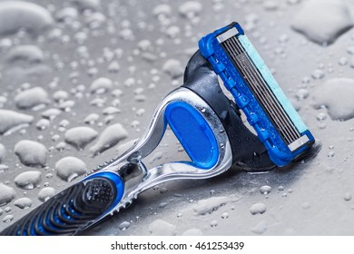 wet disposable razor isolated.closeup