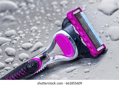 wet disposable razor woman isolated.closeup