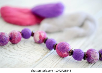 Wet felting beads and colorful yarn closeup. Handcraft concept.