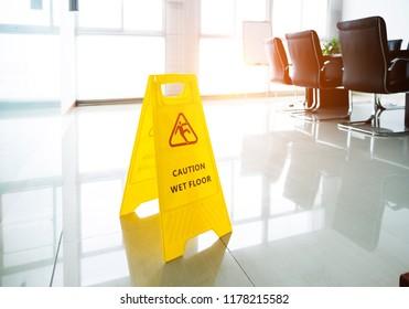 Wet floor caution sign in office.