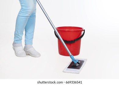 Wet floor cleaning. Woman with bucket and mop close-up. Housewife in the process of house cleaning isolated on white background