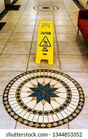 Wet floor sign in the hotel corridor