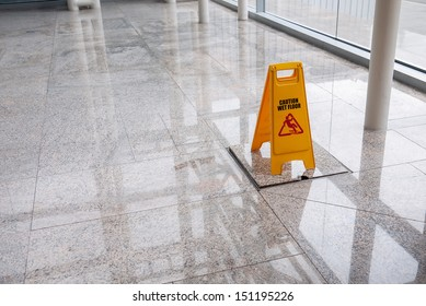 wet floor sign on lobby floor