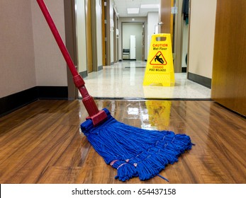 Wet floor sign out while mopping for safety