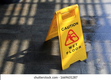 wet floor with under construction sign