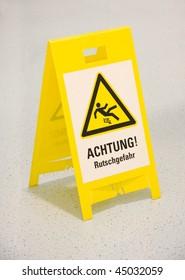 Wet floor warning sign in german