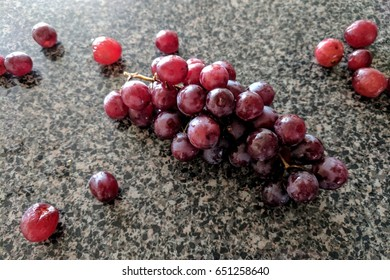 wet grapes on countertop